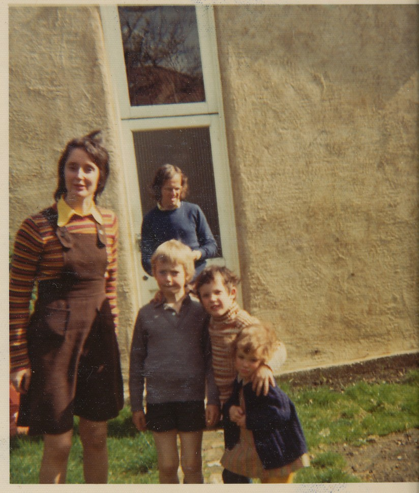 JM and family outside his garden studio